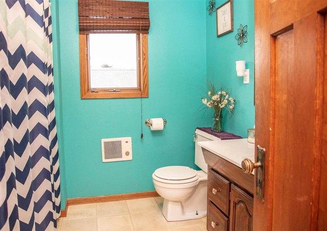 Bathroom featured at 401 SW 3rd Ave, Tripoli, IA 50676