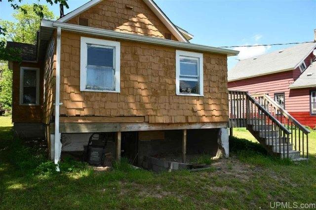 Porch yard featured at 3545 County Road AAJ Unit 65, Champion, MI 49814