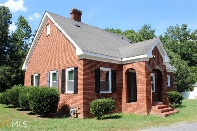 Porch yard featured at 400 Fourth St, Summerville, GA 30747