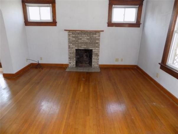 Living room featured at 1115 Roemer Blvd, Farrell, PA 16121