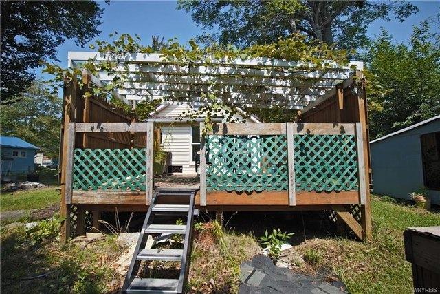 Porch yard featured at 239 Dawn Ave, Angola, NY 14006