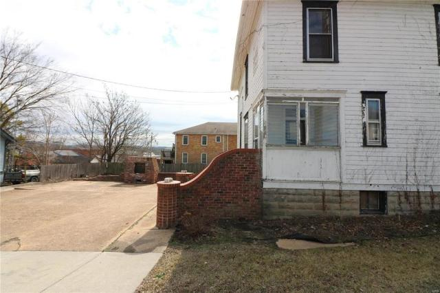 Road view featured at 222 N 1st St, Pacific, MO 63069
