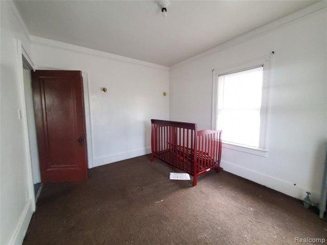 Bedroom featured at 7400 Prairie St, Detroit, MI 48210