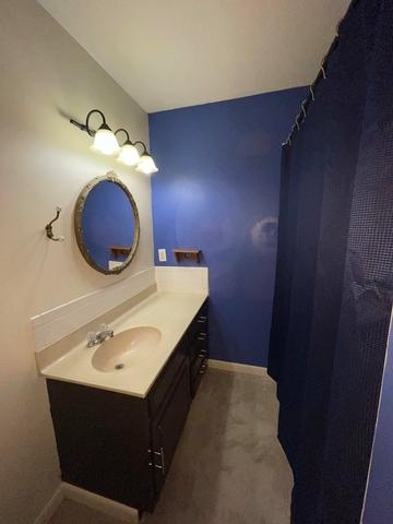 Bathroom featured at 1521 Grand Ave, Parsons, KS 67357
