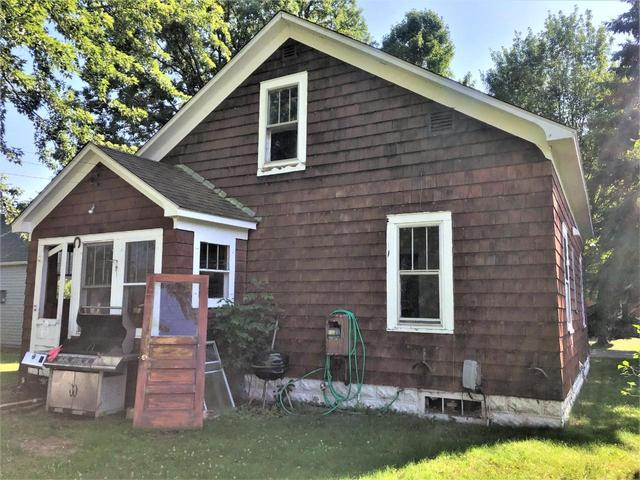 Porch yard featured at 165 Eyder Ave N, Phillips, WI 54555