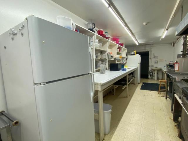 Laundry room featured at 140 Chestnut St, Louisville, IL 62858
