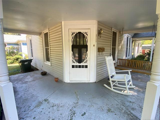Porch featured at 111 S Rosehill Ave, Cleveland, OK 74020