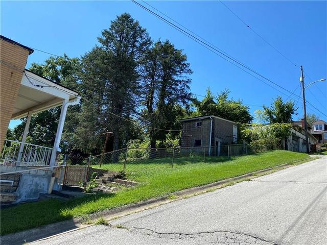 Road view featured at 2 S McKean Ave, Donora, PA 15033