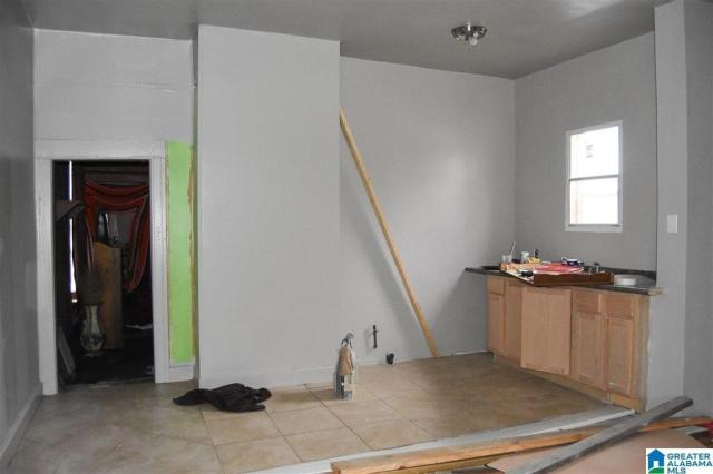 Kitchen featured at 1501 Moore Ave, Anniston, AL 36201