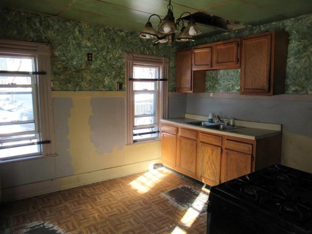 Kitchen featured at 57 Linden St, Holyoke, MA 01040