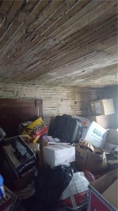 Garage featured at 300 N 1st St, Kincaid, KS 66039
