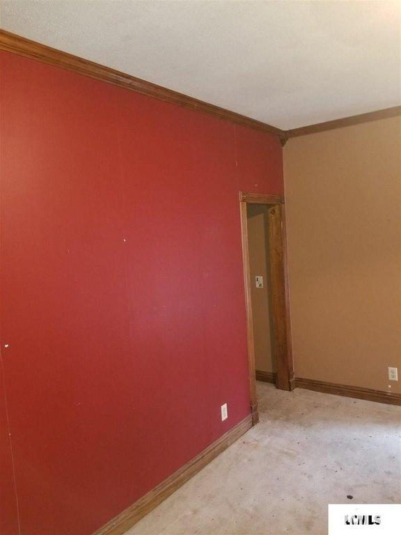 Bedroom featured at 107 NE Church St, Atlanta, IL 61723