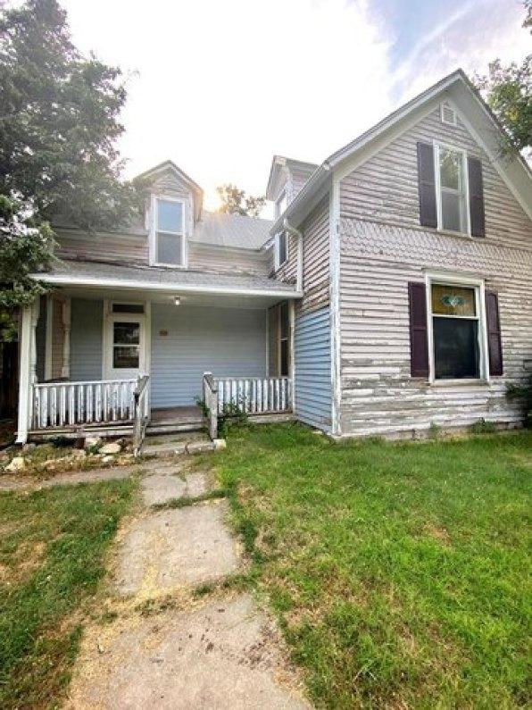 Porch yard featured at 321 N Kentucky Ave, Sylvan Grove, KS 67481