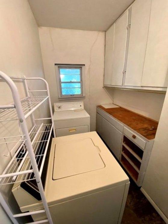 Laundry room featured at 321 N Kentucky Ave, Sylvan Grove, KS 67481