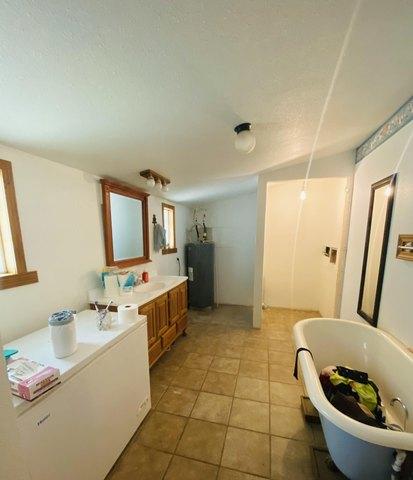 Bathroom featured at 401 E Spring St, El Dorado Springs, MO 64744