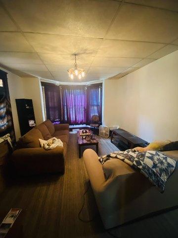 Living room featured at 401 E Spring St, El Dorado Springs, MO 64744