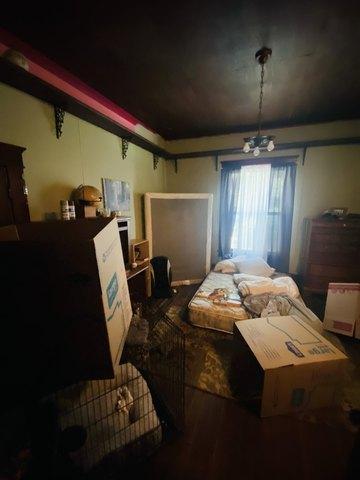 Bedroom featured at 401 E Spring St, El Dorado Springs, MO 64744