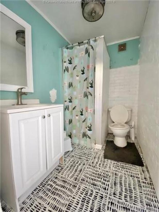 Bathroom featured at 1572 Dixie St, Charleston, WV 25311