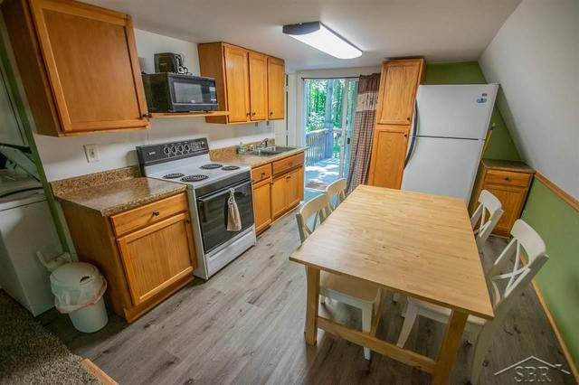 Kitchen featured at 2647 S Whitney Beach Rd, Beaverton, MI 48612