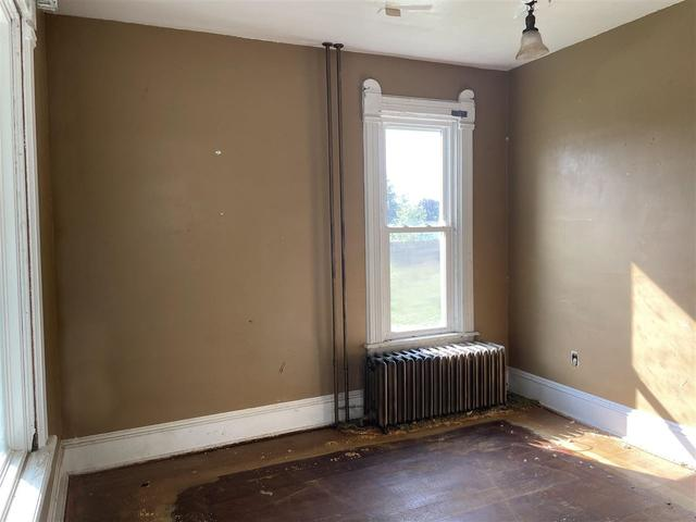 Bedroom featured at 329 E Main St, Hawkeye, IA 52147