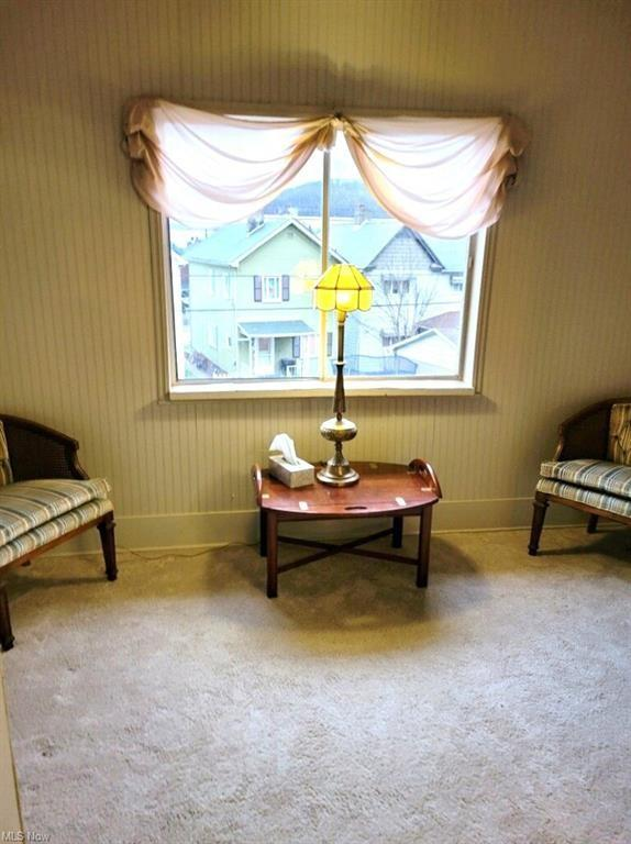 Living room featured at 845 Neville St, Follansbee, WV 26037