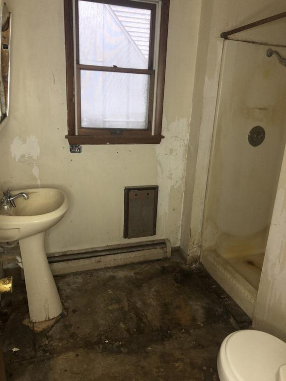 Bathroom featured at 411 W Sheffield St, Saint Anne, IL 60964