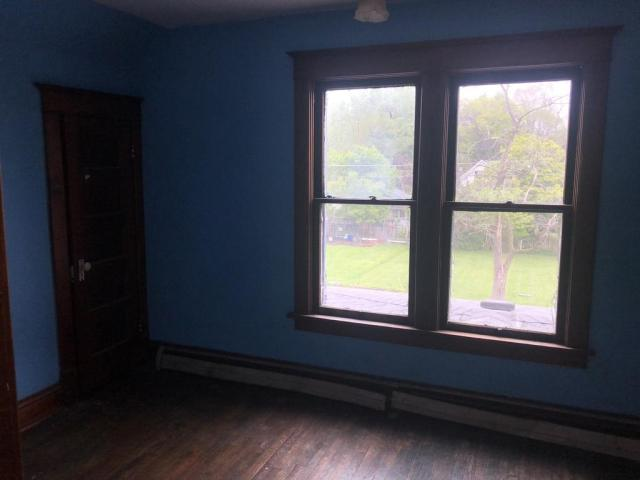 Bedroom featured at 411 W Sheffield St, Saint Anne, IL 60964