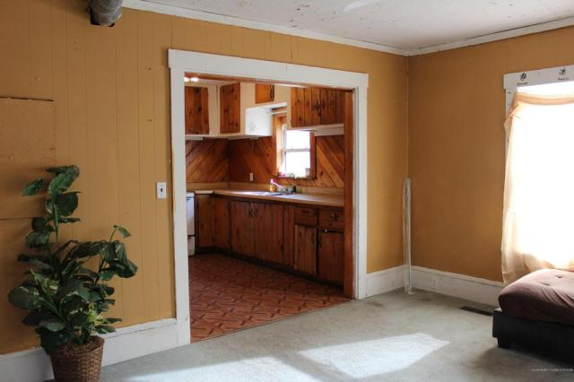 Laundry room featured at 74 Riverside St, Milo, ME 04463