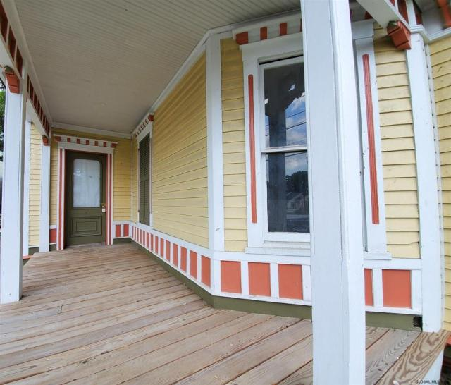 Porch featured at 21 Willett St, Fort Plain, NY 13339