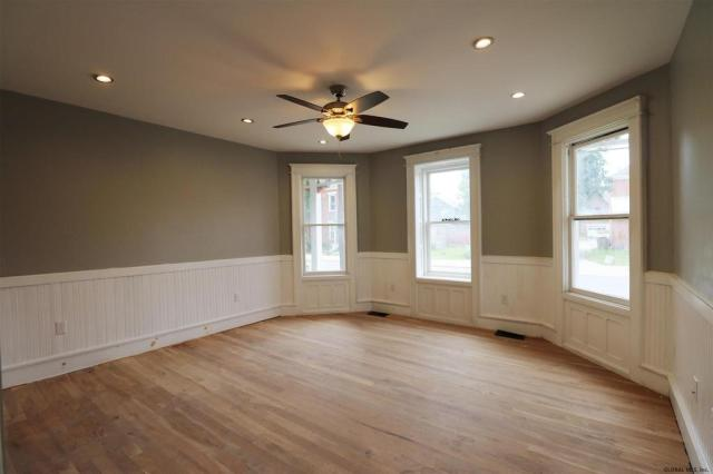 Living room featured at 21 Willett St, Fort Plain, NY 13339