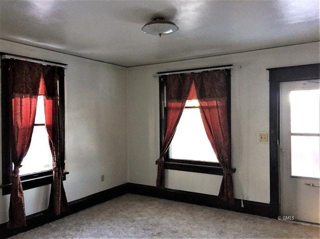 Bedroom featured at 512 E Power St, Glendive, MT 59330
