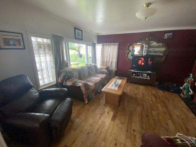 Living room featured at 127 6th Ave, Madawaska, ME 04756