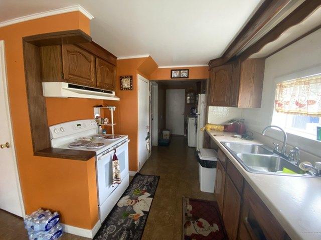 Kitchen featured at 127 6th Ave, Madawaska, ME 04756