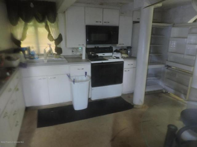 Kitchen featured at 7032 Riverrun Rd, New Port Richey, FL 34655
