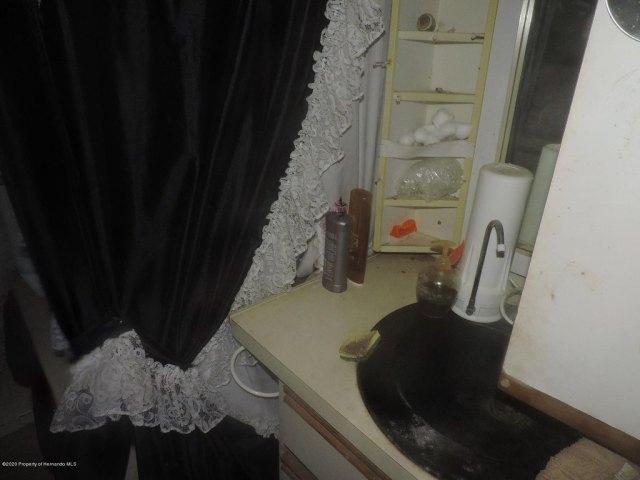 Bathroom featured at 7032 Riverrun Rd, New Port Richey, FL 34655