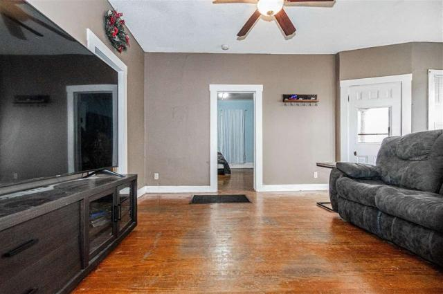 Living room featured at 703 W 8th St, Junction City, KS 66441