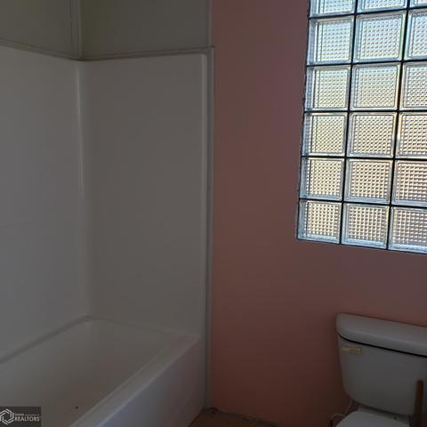 Bathroom featured at 514 W State St, Centerville, IA 52544