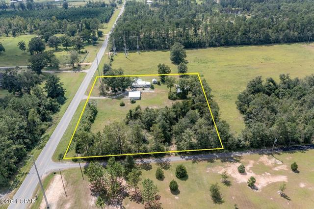 Road view featured at 660 Corbin Rd, Chipley, FL 32428