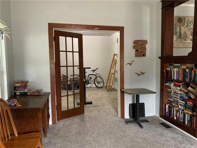 Living room featured at 501 N Walnut St, Creston, IA 50801