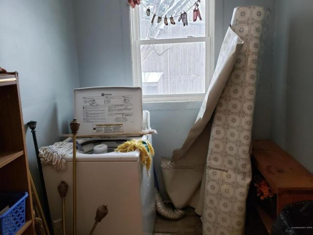 Laundry room featured at 42 Central St, Randolph, ME 04346