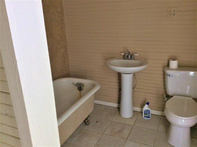 Bathroom featured at 106 Washington St N, Fort Gaines, GA 39851