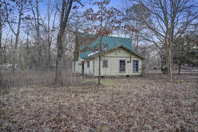 House view featured at 131 Holliman Dr, Livingston, TX 77351
