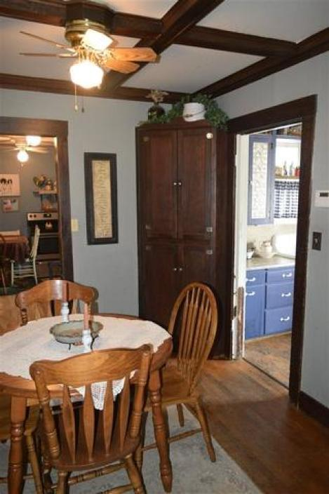 Dining room featured at 228 E 1st St, Russell, KS 67665