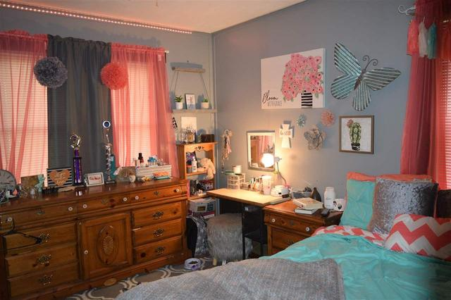 Bedroom featured at 228 E 1st St, Russell, KS 67665
