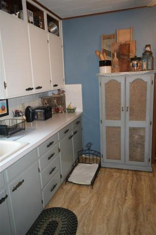 Kitchen featured at 228 E 1st St, Russell, KS 67665