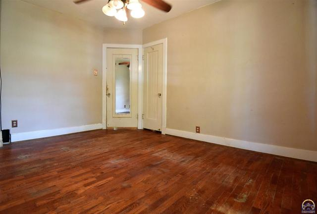 Bedroom featured at 205 NW Elmwood Ave, Topeka, KS 66606