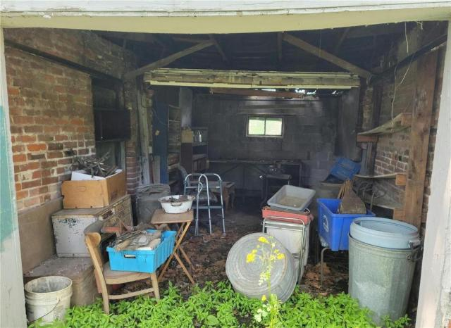 Porch yard featured at 1224 Washington Ave, Alton, IL 62002