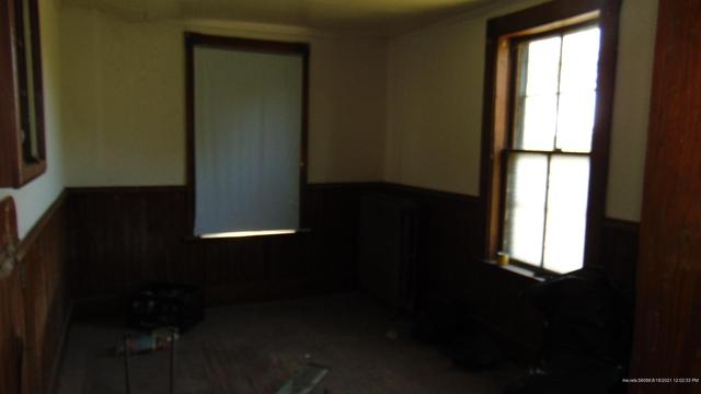 Living room featured at 23 Sewell St, Island Falls, ME 04747