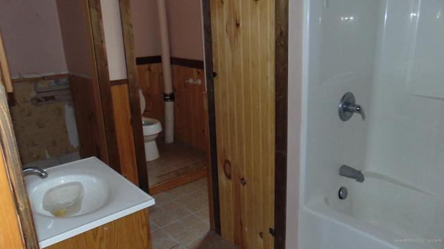Bathroom featured at 23 Sewell St, Island Falls, ME 04747