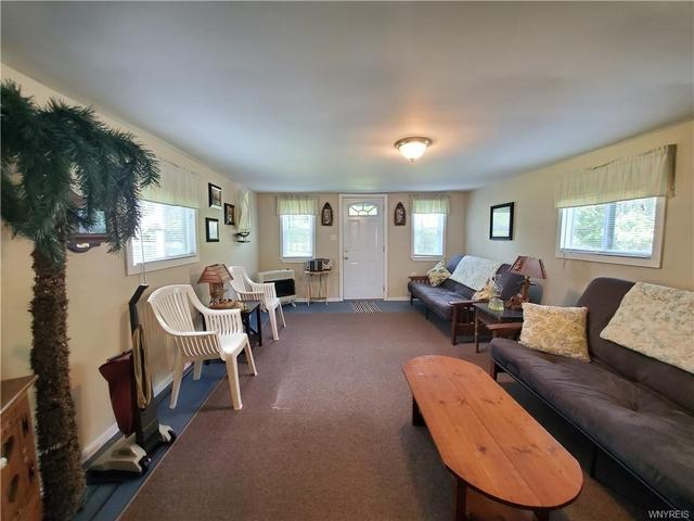 Living room featured at 9705 Pearl St, Angola, NY 14006